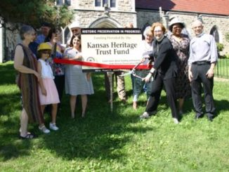 The Rev. Dixie Roberts Junk, the priest-in-charge at St. Paul's Episcopal Church, 1300 N. 18th St., Kansas City, Kan., recently cut the ribbon which marked the start of construction on repairing the church's roof. (Submitted photo)