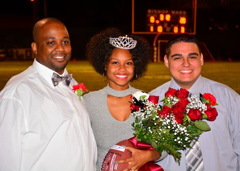 Bishop Ward senior Kiandra Hobley posed with her father and senior Michael Ledesma after being crowned as Bishop Ward's homecoming queen. (Photo by Brian Turrel)