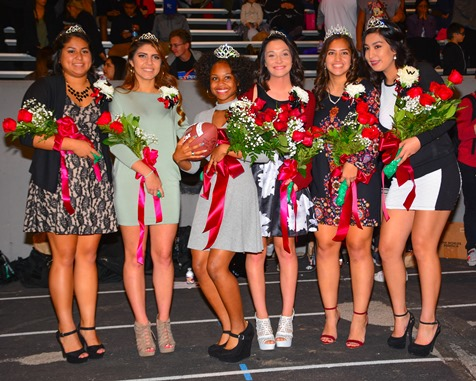 Bishop Ward homecoming queen Kiandra Hobley (third from left) posed with the members of the homecoming court at halftime of the football game against Sumner High School on Sept. 30. (Photo by Brian Turrel)