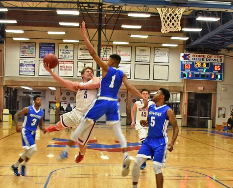 Kellen Turner, whose dramatic 3-point goal nearly forced a second overtime, didn't get a basket with this acrobatic move  but it did give the KCKCC guard two crucial free throws in the Blue Devils' 80-78 loss to Iowa Western Tuesday. (KCKCC photo by Alan Hoskins)