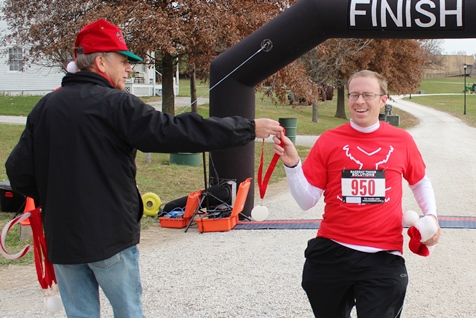 It's not always about how you start. Sometimes it's about how you finish. Runners at the Santa Express 5K and Reindeer Route at the National Agricultural Center and Hall of Fame, Bonner Springs, finished their 5K and 1-mile routes Saturday with style. (Photo by Steve Rupert)