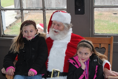 What do I want for Christmas? Let me think ... Children met with Santa Claus on Saturday at the National Agricultural Center and Hall of Fame, Bonner Springs, to talk about their Christmas wishes. More visits with Santa Claus are scheduled from 10 a.m. to 2 p.m. Sunday, Dec. 4, Saturday, Dec. 10, and Sunday, Dec. 11, at the Ag Hall, 126th and State Avenue, Bonner Springs. For more information, visit http://www.aghalloffame.com. (Photo by Steve Rupert)